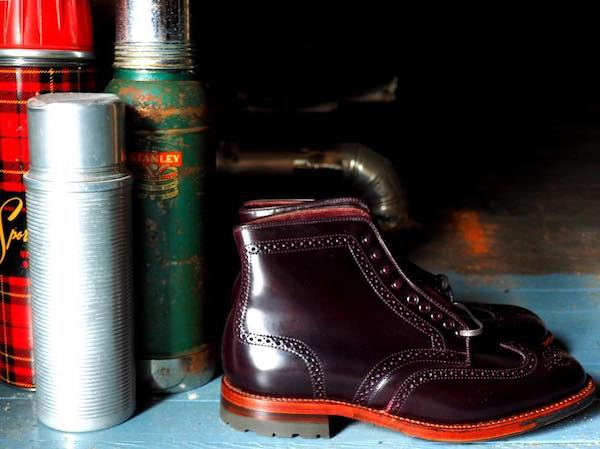 Wing tip boots on antique edge